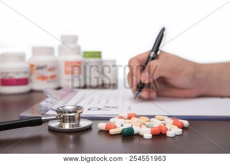 Male Doctor Hands Writing Rx Prescription. Healthcare Concept.
