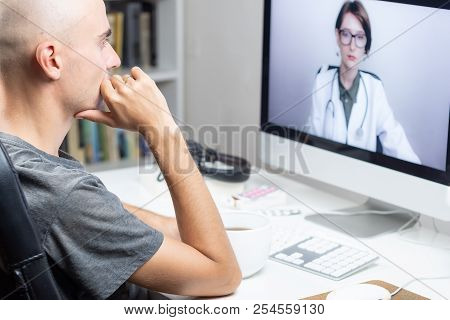 Digital Health Concept: A Patient Having Online Meeting With A Practicing Physician From Home. Medic