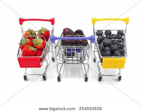 Fresh Summer Fruits, Cherry, Strawberry, And Blueberry In Shopping Cart Or Trolly Isolated On White