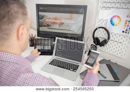 Designer Working On Responsive Web Design Project