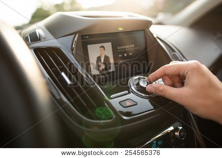 Man Using Car Multimedia Audio System. Internet Car Radio With Touchscreen