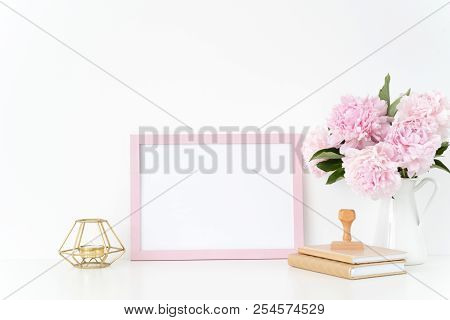 Pink Landscape Frame Mock Up With A Pink Peonies, Candle And Stamp Beside The Frame, Overlay Your Qu