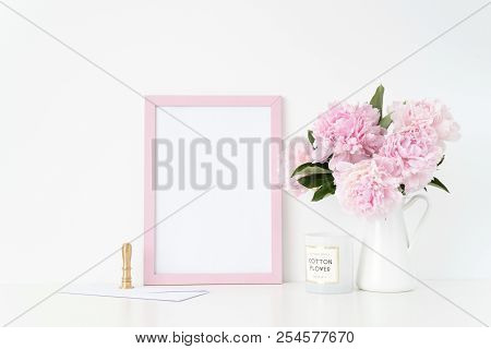 Feminine Pink Portrait Frame Mock Up With A Pink Peonies In Jug And Stamp Beside The Frame, Overlay