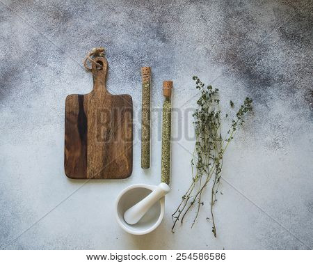 Collection Of Herbs. Raw Material For Processing. Mortar, Pestle, Board, Test Tubes With Herbs And S