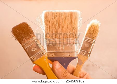 Brush In Hand For Painting Walls. Repair