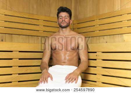 Man relaxing in a sauna bath