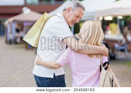 Mature couple shopping in a street market
