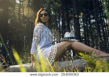 Beautiful woman in nature. Beautiful woman posing in nature. Beautiful woman relaxes ain forest. Beautiful young woman in nature. Beautiful. Woman. Forest. Beauty in nature.