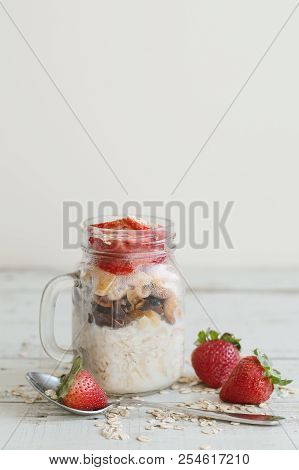Overnight Oats In A Jar With Strawberry On Wooden Table, Vertical Photo. Healthy Breakfast Recipe Wi