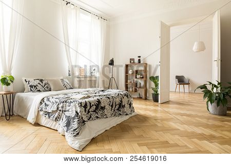 Stylish Apartment Interior With White Walls And Herringbone Wooden Floor. A View From A Bedroom With