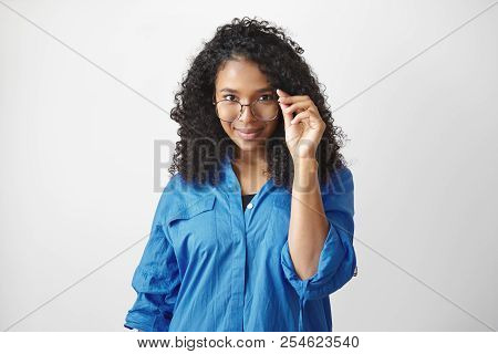 Studio Shot Of Attractive Fashionable Young African American Female With Voluminous Black Hair Posin