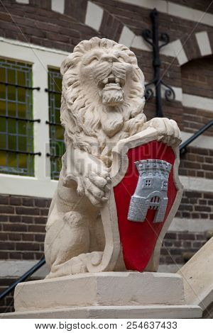 Alkmaar, Netherlands - June 01, 2018: Lion that carries the coat of arms in front of the townhall of Alkmaar