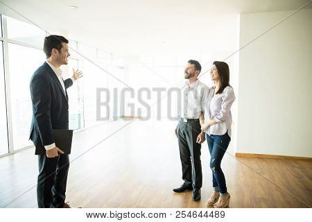 Real Estate Broker Showing Mid Adult Couple A New House
