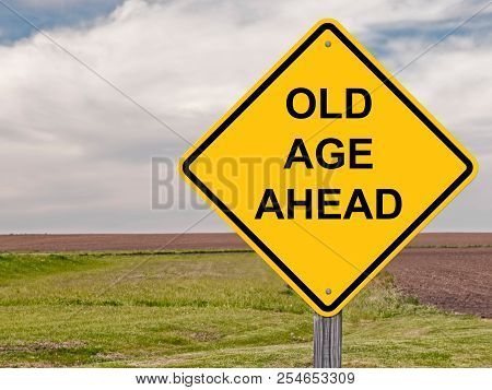 Old Age Ahead Caution Sign With Landscape Background