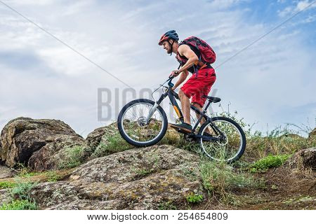 Cyclist Riding Down The Rock On A Mountain Bike, Extreme Enduro Cycling.