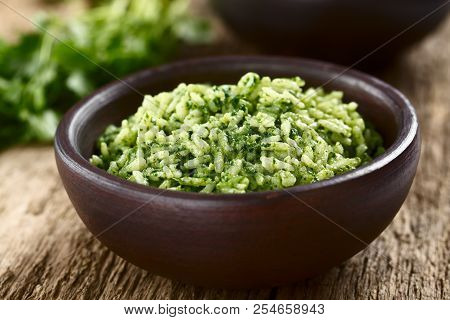 Traditional Mexican Arroz Verde Green Rice Dish Made Of Long-grain Rice, Spinach, Cilantro And Garli