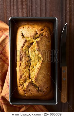 Fresh Homemade Pumpkin Bread In Pan, Photographed Overhead (selective Focus, Focus On The Top Of The