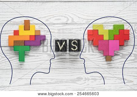 Heart Vs Mind. Heart Versus Brain. Concept Of Mind Against Love. Heads Of Two People With Colourful