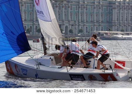 ST. PETERSBURG, RUSSIA - AUGUST 3, 2018: Team Yacht Club Sopot from Poland compete in Semifinal 2 of Sailing Champions League. 25 sailing teams participate in the competitions