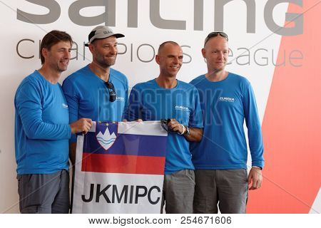 ST. PETERSBURG, RUSSIA - AUGUST 3, 2018: Sailing team JK MIPC from Slovenia make group photo during Semifinal 2 of Sailing Champions League. 25 sailing teams take part in the competitions