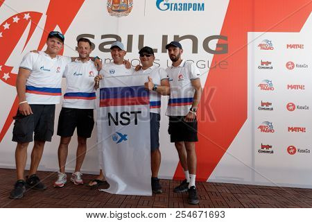 ST. PETERSBURG, RUSSIA - AUGUST 3, 2018: Athletes from Russia make group photo during Semifinal 2 of Sailing Champions League. 25 sailing teams take part in the competitions