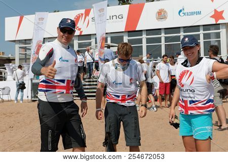 ST. PETERSBURG, RUSSIA - AUGUST 3, 2018: Athletes from UK on the beach before the race during Semifinal 2 of Sailing Champions League. 25 sailing teams take part in the competitions
