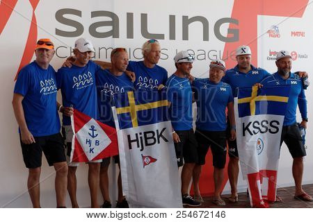 ST. PETERSBURG, RUSSIA - AUGUST 3, 2018: Athletes from Sweden make group photo during Semifinal 2 of Sailing Champions League. 25 sailing teams take part in the competitions
