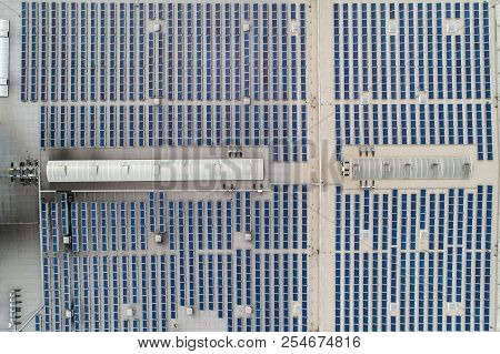 Aerial Top Down View On Many Solar Panels Rows Lined Up On Of Factory Roof