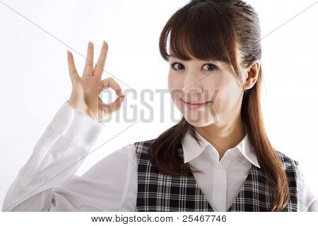 Beautiful business woman showing okay sign