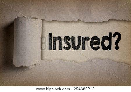 Insured Written Under Torn Paper. Insurance Concept.