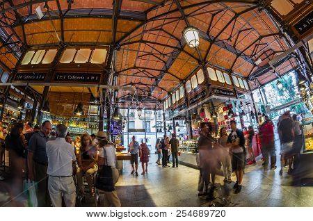 Madrid, Spain - August 27, 2017: People Visiting And Enjoying Drinks And Tapas Inside The Historical