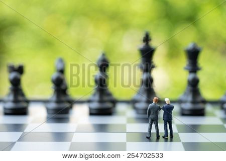 Partnership And Teamwork In Business Strategy Concept, Two Miniature People Businessmen Work As Team