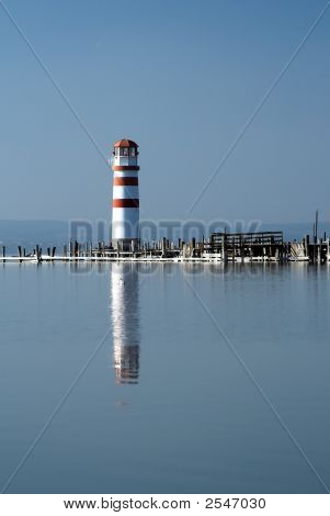 Lighthouse With Reflection