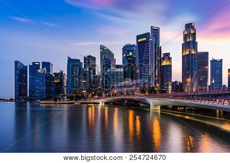 Singapore - March 25, 2017: Singapore Skyline Dusk And Illuminated Financial District Night View, Do