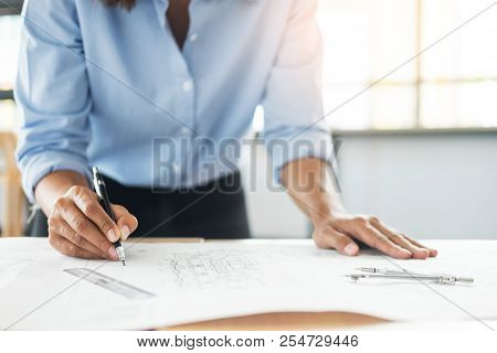 Person's Engineer Hand Drawing Plan On Blue Print With Architect Equipment, Architects Working At Th