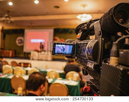 Close Up Professional Video Camera In Conference Hall Or Seminar Room With Attendee Background,educa