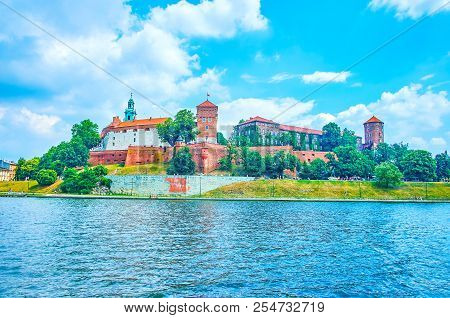 Beautiful medieval royal residence Wawel Castle nowadays serves as museum, located on the bank of Vistula River, Krakow, Poland poster