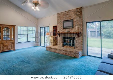 Simple living room in need of remodel.