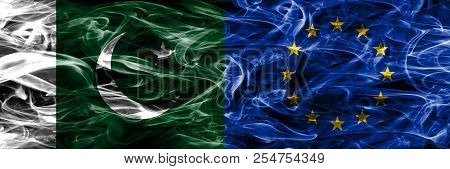 Pakistan Vs European Union Smoke Flags Placed Side By Side. Thick Colored Silky Smoke Flags Of Pakis