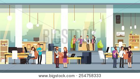 Coworkers In Office. People In Coworking Open Space Office, Workspace. Employees Talking And Brainst