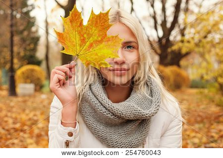 Autumn Woman With Fall Leaf Walking Outdoors