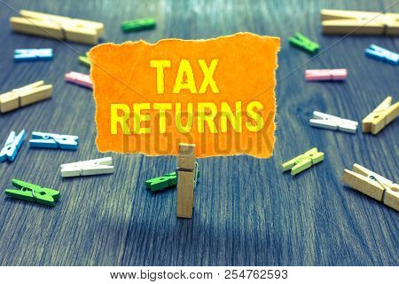 Conceptual Hand Writing Showing Tax Returns. Business Photo Text Tax Payer Financial Information Tax
