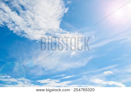 Blue Sky Background With White Dramatic Colorful Clouds And Sunlight Beams. Sky Landscape Scene. Sky