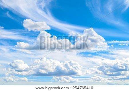 Blue Sky Background With White Dramatic Colorful Clouds And Sunlight. Beautiful Sky Landscape View.