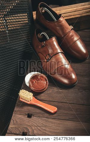 Vertical Photos Of Male Monk Shoes And Brown Shoe Polish