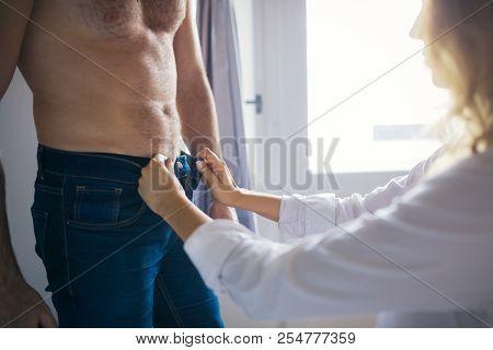 Beautiful Blonde Woman In Lingeri, Unzipping Man Jeans
