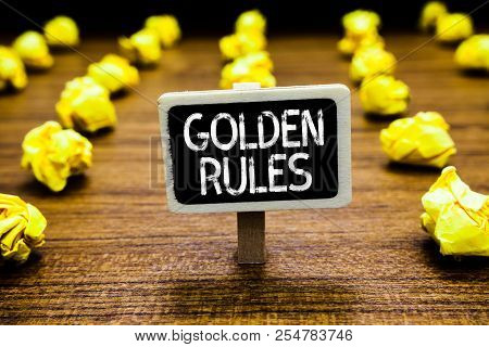 Handwriting text Golden Rules. Concept meaning Basic principle that should be followed Important Principle Blackboard crumpled papers several tries mistake not satisfied wooden floor. poster