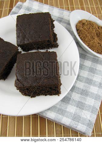 Fresh Baked Tasty Dark Carob Cake On A Plate