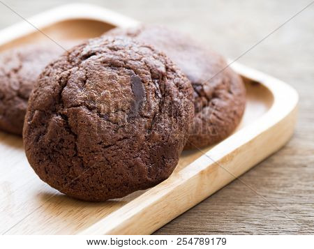 Homemade Soft Dark Chocolate Brownie Cookies Placed On A Wooden Plate. The Cookies Is Look Good And
