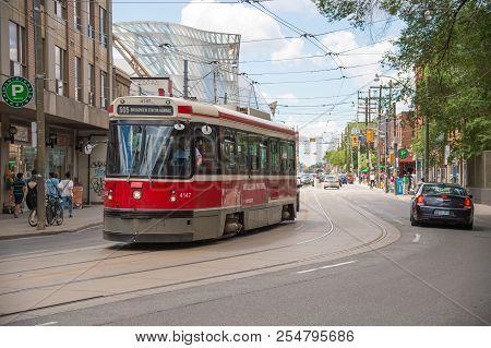 Toronto, Canada - 2 July 2016: Toronto Streetcar On The Move In Downtown Toronto.